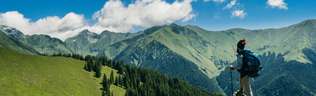 LinkedIn Banner Image Example of Someone Hiking In The Mountains
